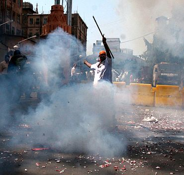 A man bursts firecrackers at the Bhendi Bazaar area. Muslim clerics and scholars have welcomed the capital punishment awarded to Kasab, saying that the court verdict has reiterated the faith of all countrymen in Indian judicial system