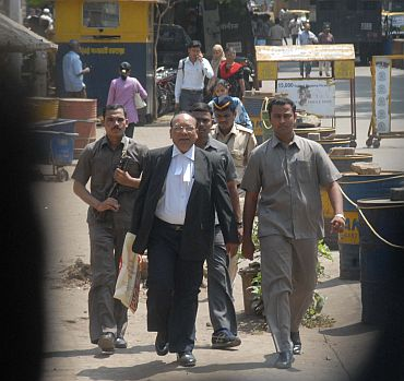 Kasab's counsel KP Pawar exits the court post verdict. Talking to media persons, he said: 'I will not criticise the verdict. If an accused is not satisfied with the verdict given by a court, he can appeal in the higher courts'