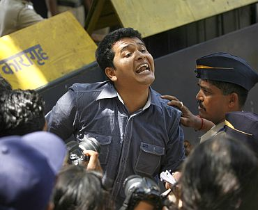 A news reporter rushes out of Arthur Road Jail as he breaks the news about Mohammad Ajmal Kasab's death sentence