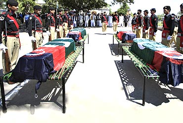 Policemen attend the funeral ceremony of five policemen killed by a Taliban bomber