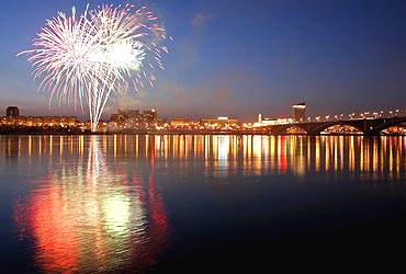 Fireworks explode above the Yenisei River