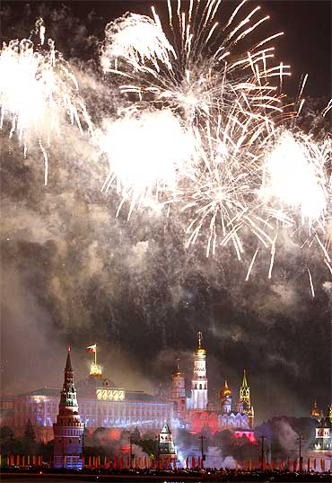 Fireworks explode above Moscow's Kremlin and the Moskva River