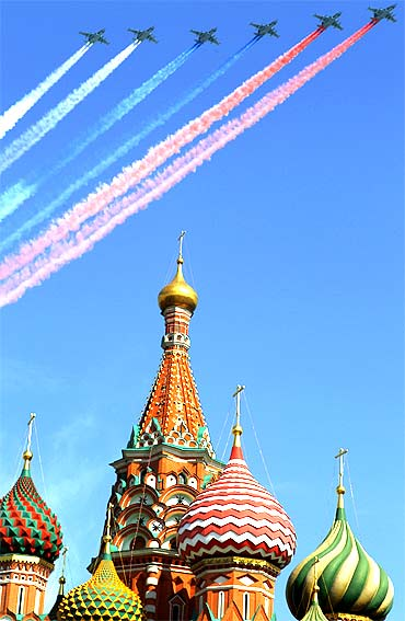 A group of Russian military jets fly over St Basil's Cathedral