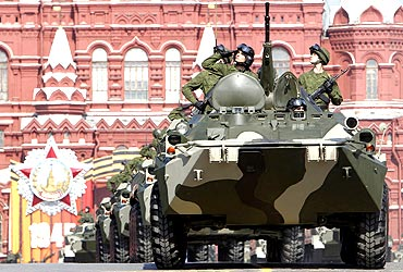 Russian soldiers drive armoured personnel carriers