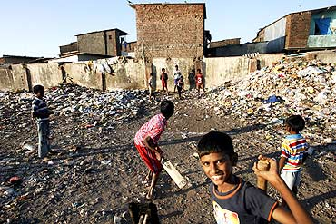 Slum children play cricket at Nehru Nagar slums in Mumbai