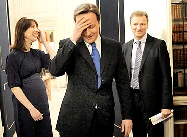 Prime Minister David Cameron, centre, and his wife Samantha enter 10 Downing Street, the British prime minister's home