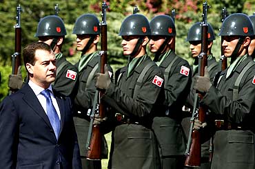 Russia's President Dmitry Medvedev reviews a honour guard at the presidential palace