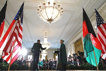US President Barack Obama and Afghan President Hamid Karzai at a news conference in the East Room at the White House