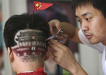 A man gets haircut featuring Tiananmen Gate in Zhengzhou