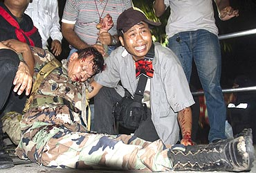 General Khattiya Sawasdiphol moments after being shot
