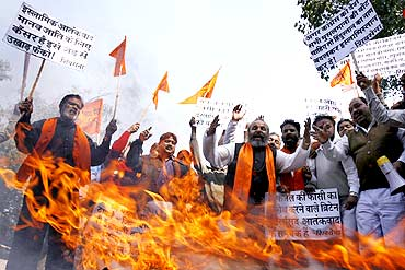 Shiv Sena activists shout slogans against Afzal Guru