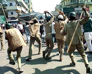 Police chase Rashtriya Janata Dal supporters in Patna, Bihar.
