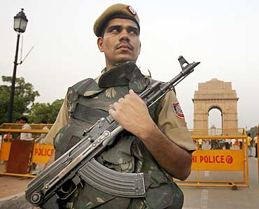 A policeman stands guard at India Gate in New Delhi.
