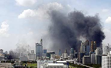 Smoke rises over buildings in Bangkok as violence rocked the city on Wednesday