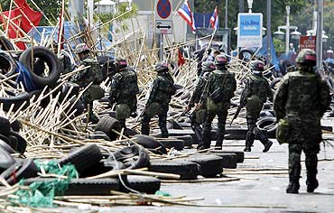 Thai soldiers patrol near the protestors' barricade