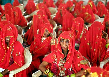 Muslim brides participate in a mass wedding ceremony in Ahmedabad