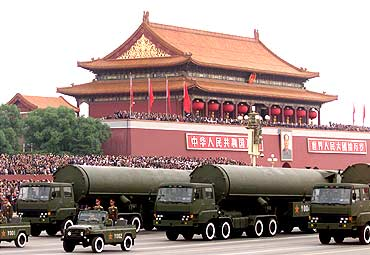 Chinese-made Dong Feng-31 intercontinental ballistic missiles pass through Tiananmen Square