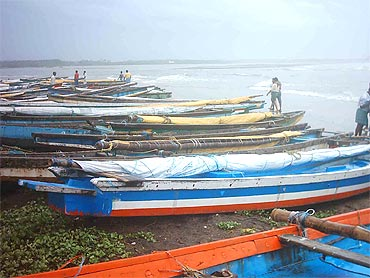 Fishermen anchor their boats in Visakhapatnam after the cyclone alert