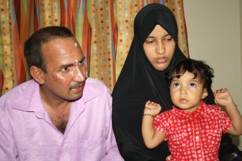 Abdullah Islamil with his wife and child at the hospital