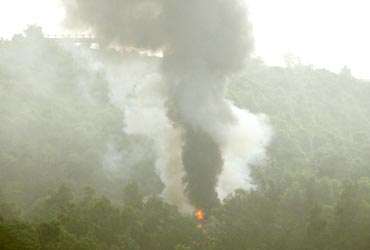 Smoke from the plane that crashed in a forested area