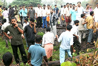 Locals gather near the crash site