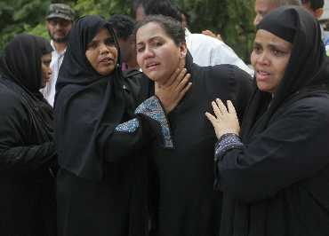 Relatives of the victims of the plane crash mourn
