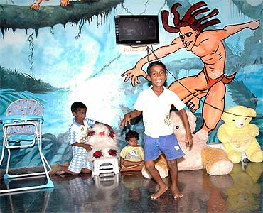 Children play at the toddlers' room in Anada Illam