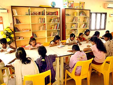 Children in Anada Illam's library