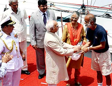 Commander Dilip Donde is greeted by Vice President Hamid Ansari after his return to Mumbai
