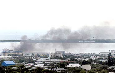 Smoke billows over the Tivoli Gardens community in Kingston.