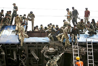 Army and police personnel participate in rescue operations