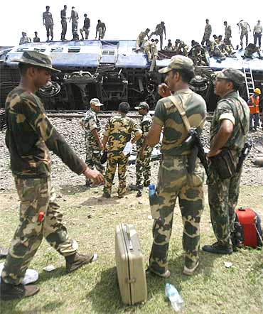 Paramilitary personnel at the crash site