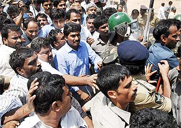 Jagan being taken away by the police