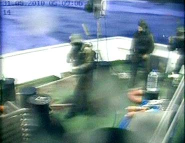 Israeli commandos are seen on a Gaza-bound ship in the Mediterranean Sea in this frame grab.