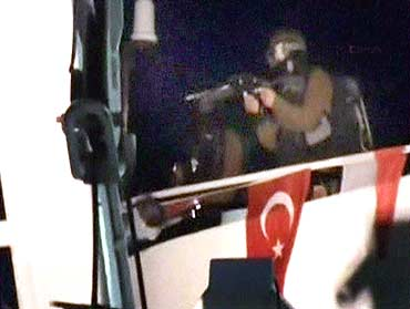 An Israeli commando lands on a Gaza-bound ship in the Mediterranean Sea,