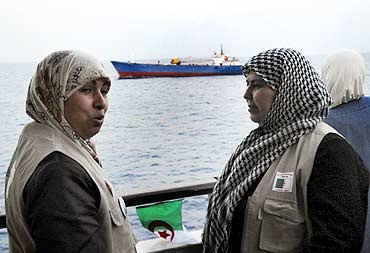 Activists chat on the Turkish ship Mavi Marmara, on its way to Gaza mission