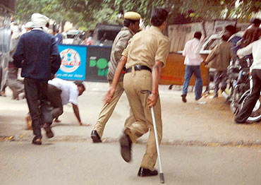 Police chase away pro Telangana protestors in Hyderabad on Monday