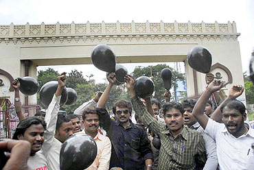 Protestors display black balloons of protest in Hyderabad