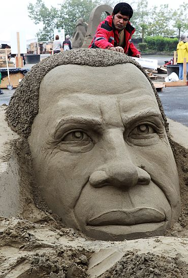 Sand artist Sudarsan Pattnaik of India works on a likeness of US President Barrack Obama  at the World Championship of Sand Sculpting in Washington, DC