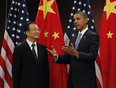 US President Obama gestures alongside China's Premier Wen at the United Nations in New York