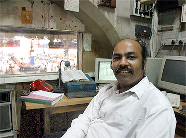 Railway announcer Vishnu Zende in his cabin at CST