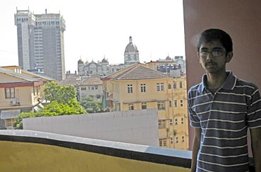 Juzer with the Taj Mahal hotel, where the Obamas will stay, clearly visible from the school