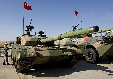 A Chinese soldier checks a PLA ZTZ-99 tank during the Peace Mission 2010 exercises in Kazakhstan