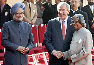 Then US President George W Bush with then President A P J Abdul Kalam and Dr Singh in New Delhi