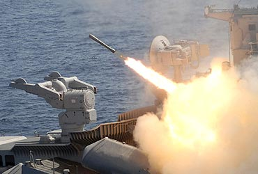 A surface-to-air missile is fired from the naval warship 'Rana'