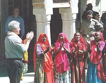 File photo shows President Clinton with Rajasthani women