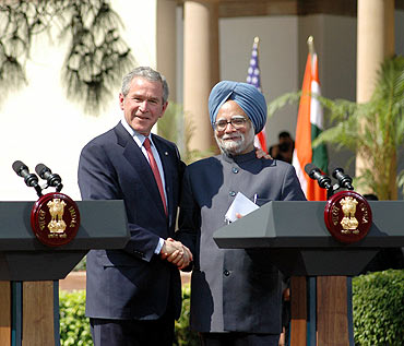 File photo shows Prime Minister Dr Manmohan Singh with US President George W Bush