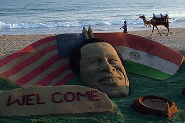 A sand sculpture of U.S. President Barack Obama on a beach in Puri