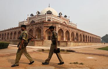 Indian security personnel keep watch inside the lawns of Humayun's Tomb in New Delhi