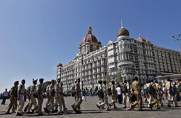 Policemen arrive for deployment at the Taj Mahal Hotel as part of security measures ahead of US President Barack Obama's visit